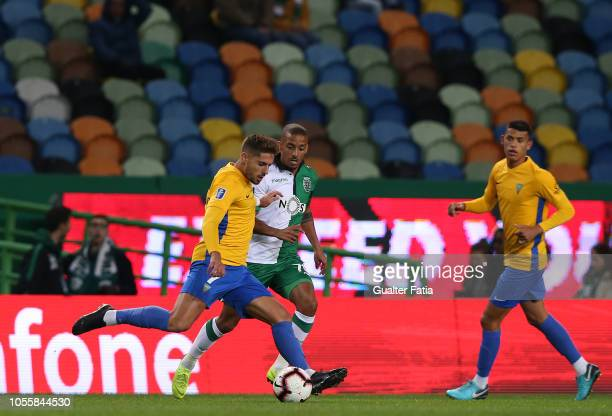 Joao Vigario of GD Estoril Praia with Bruno Gaspar of Sporting CP in action during the Portuguese League Cup match between Sporting CP and GD Estoril...