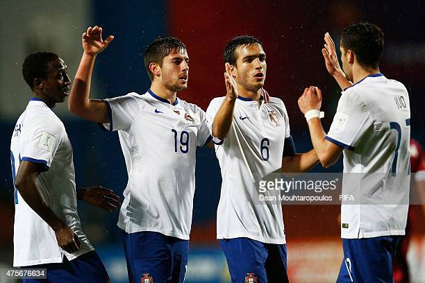 Joao Vigario of Portugal celebrates after he shoots and scores the fourth goal of the game with team mates Ivo Rodrigues Tomas Podstawski and Janio...