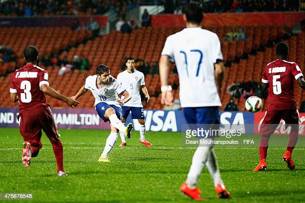Joao Vigario of Portugal shoots and scores the fourth goal of the game during the FIFA U20 World Cup New Zealand 2015 Group C match between Qatar and...