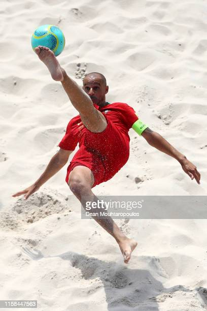 Joao Vitor Tavares Saraiva or Madjer attempts a scissor or bicycle kick shot on goal during the Beach Soccer or Fooball Men's First Round group A...