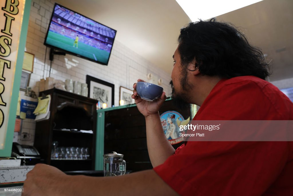 Joao Yniquez watches the opening soccer match of the 2018 FIFA World Cup at Cafe Max in Russian enclave Brighton Beach June 14, 2018 in the Brooklyn borough of New York City. The 2018 World Cup, one the world's premier sporting events, is being hosted by Russia this year as the country looks to improve its relations with the West.
