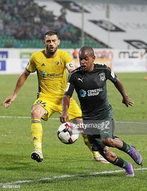 Joaozinho of FC Krasnodar is challenged by Alexandru Gatcan of FC Rostov during the Russian Premier League match between FC Krasnodar v FC Rostov at...