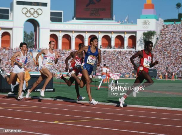 Joaquim Cruz of Brazil races to the gold medal against Edwin Koech, Steve Ovett, Sebastian Coe and Earl Jones during the final of the Men's 800...