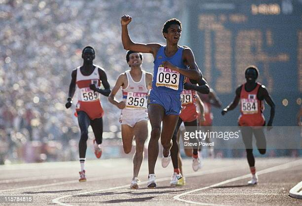 Joaquim Cruz of Brazil races to the gold medal against Sebastian Coe Billy Konchellah Edwin Koechand Earl Jones during the final of the Men's 800...