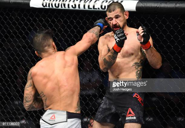 Joaquim Silva of Brazil punches Vinc Pichel in their lightweight bout during a UFC Fight Night event at Spectrum Center on January 27 2018 in...