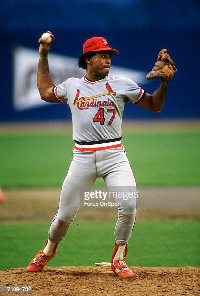 Joaquin Andujar of the St Louis Cardinals turns to throw to first base against the New York Mets during an Major League Baseball game circa 1983 at...