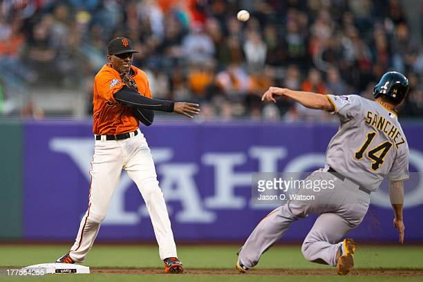 Joaquin Arias of the San Francisco Giants completes a double play over Gaby Sanchez of the Pittsburgh Pirates during the second inning at ATT Park on...