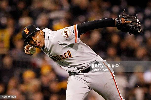 Joaquin Arias of the San Francisco Giants fields a ball in the eighth inning against the Pittsburgh Pirates during the National League Wild Card game...