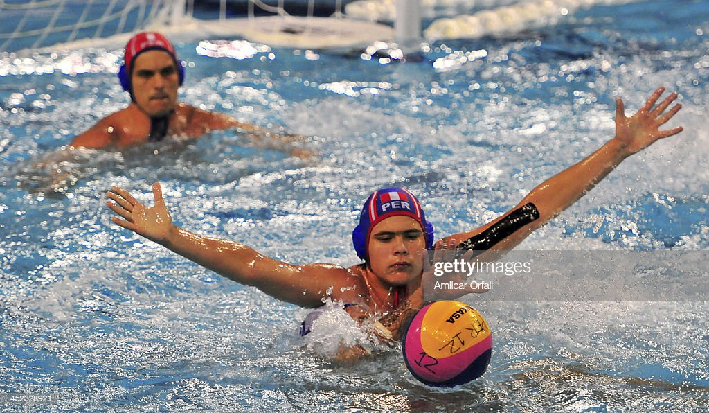 Joaquin Armando Lopez of Venezuela fights for the ball with Javier Hinojosa of Peru during a match between Peru and Venezuela as part of the XVII Bolivarian Games Trujillo 2013 at Campo de Marte on November 27, 2013 in Lima, Peru.