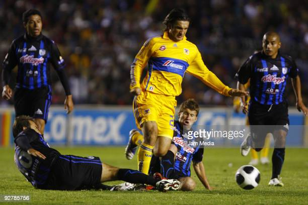 Joaquin Beltran and Omar Tena of Queretaro vie for the ball with Francisco Fonseca during the Closing 2009 Tournament in the Mexican Football League...