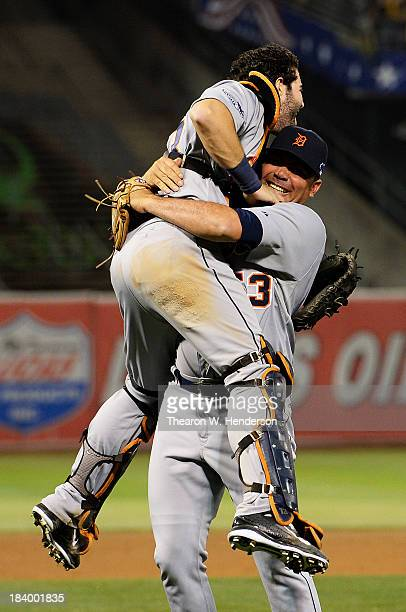 Joaquin Benoit of the Detroit Tigers celebrates their 3 to 0 win over the Oakland Athletics with Alex Avila in Game Five of the American League...