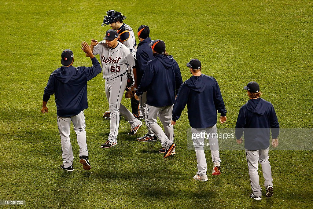 Joaquin Benoit #53 of the Detroit Tigers celebrates with teammates after defeating the Boston Red Sox 1-0 in Game One of the American League Championship Series at Fenway Park on October 12, 2013 in Boston, Massachusetts.