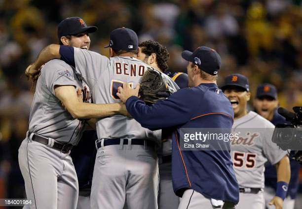 Joaquin Benoit of the Detroit Tigers is congratulated by teammates including Justin Verlander after they beat the Oakland Athletics in Game Five of...