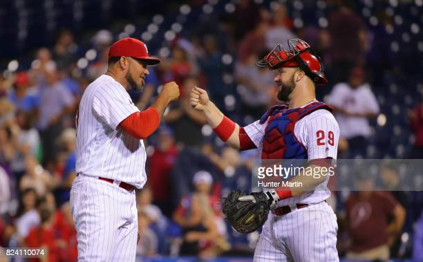 Joaquin Benoit of the Philadelphia Phillies is congratulated by Cameron Rupp after finishing a game against the Atlanta Braves at Citizens Bank Park...