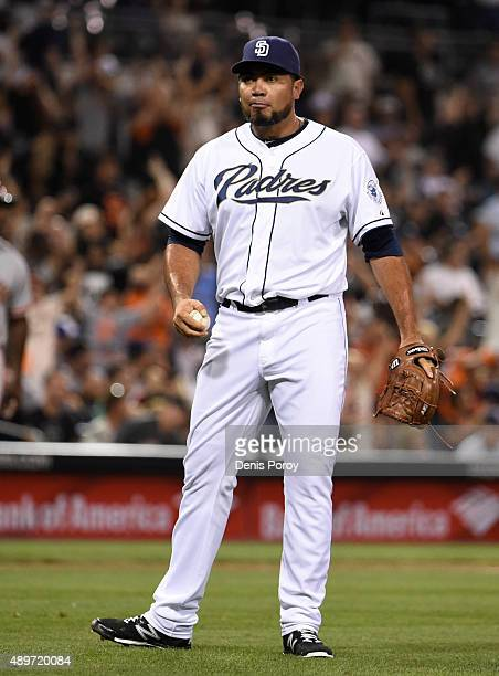 Joaquin Benoit of the San Diego Padres looks to the infield after giving up a solo home run to Jarrett Parker of the San Francisco Giants during the...