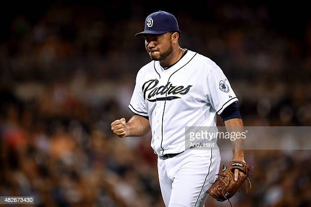 Joaquin Benoit of the San Diego Padres pumps his fist after pitching in the 8th inning during the game against the Miami Marlins at Petco Park on...