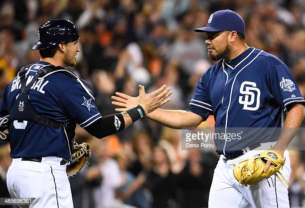 Joaquin Benoit of the San Diego Padres right is congratulated by Yasmani Grandal after getting the final out during the ninth inning of a baseball...