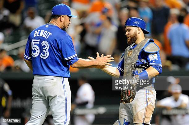 Joaquin Benoit of the Toronto Blue Jays celebrates with Russell Martin after a 51 victory against the Baltimore Orioles at Oriole Park at Camden...