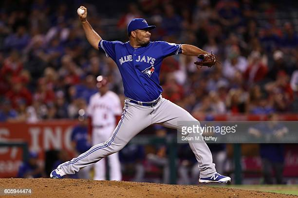 Joaquin Benoit of the Toronto Blue Jays pitches during the seventh inning of a game against the Los Angeles Angels of Anaheim at Angel Stadium of...