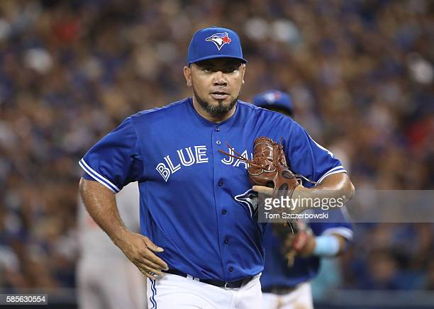 Joaquin Benoit of the Toronto Blue Jays reacts after getting the last out of the eighth inning during MLB game action against the Baltimore Orioles...