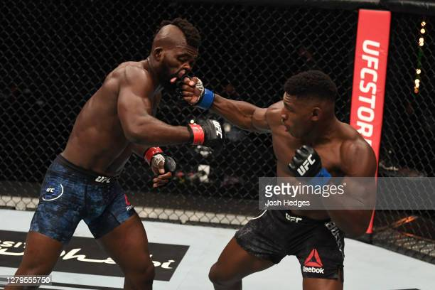 Joaquin Buckley punches Impa Kasanganay in their middleweight bout during the UFC Fight Night event inside Flash Forum on UFC Fight Island on October...