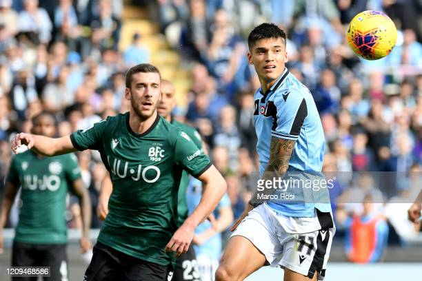 Joaquin Correa o of SS Lazio compete for the ball with Mattia Bani during the Serie A match between SS Lazio and Bologna FC at Stadio Olimpico on...