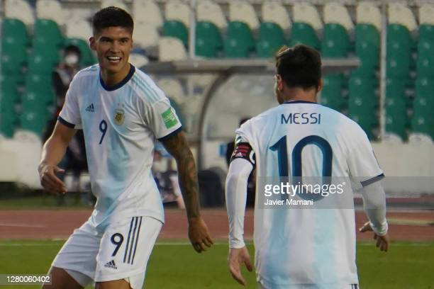 Joaquin Correa of Argentina celebrates with Lionel Messi of Argentina after scoring the second goal of his team during a match between Bolivia and...