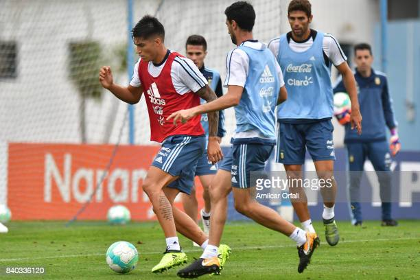 Joaquin Correa of Argentina fights for the ball with Javier Pastore of Argentina during a training session at 'Julio Humberto Grondona' training camp...