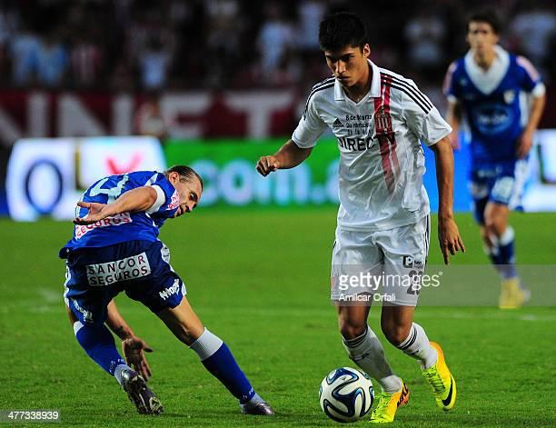 Joaquin Correa of Estudiantes and Adrian Bastia of Rafaela fight for the ball during a match between Estudiantes and Atletico Rafaela as part of...