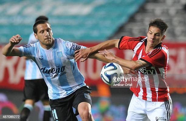 Joaquin Correa of Estudiantes and Luciano Aued of Racing Club fight for the ball during a match between Estudiantes and Racing Club as part of Torneo...