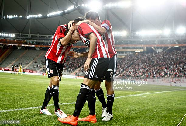 Joaquin Correa of Estudiantes and teammates celebrate the opening goal during a match between Estudiantes and Peñarol as part of round of 16 of Copa...