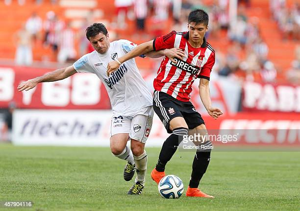 Joaquin Correa of Estudiantes fights for the ball with Rodrigo Braña of Quilmes during a match between Estudiantes and Quilmes as part of 13th round...