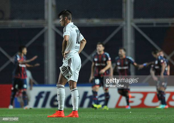 Joaquin Correa of Estudiantes looks dejected while players of San Lorenzo celebrate during a match between San Lorenzo and Estudiantes as part of...