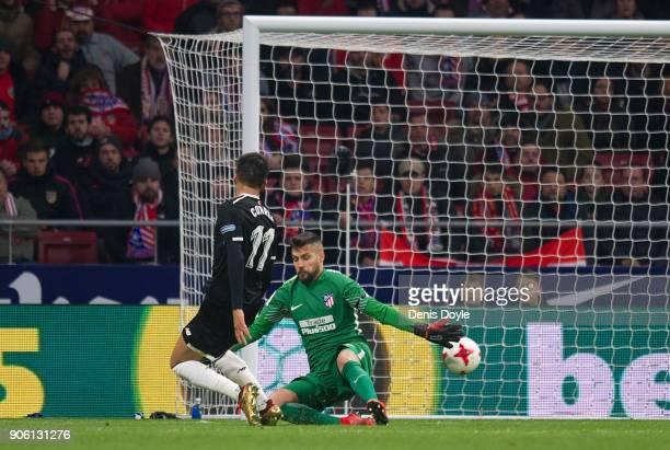 Joaquin Correa of Sevilla beats Miguel Moya of Atletico de Madrid to score his team's 2nd goal during the Copa del Rey Quarter Final First Leg match...