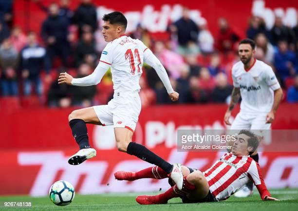 Joaquin Correa of Sevilla CF duels for the ball with Inigo Cordoba of Athletic Club during the La Liga match between Sevilla CF and Athletic Club at...