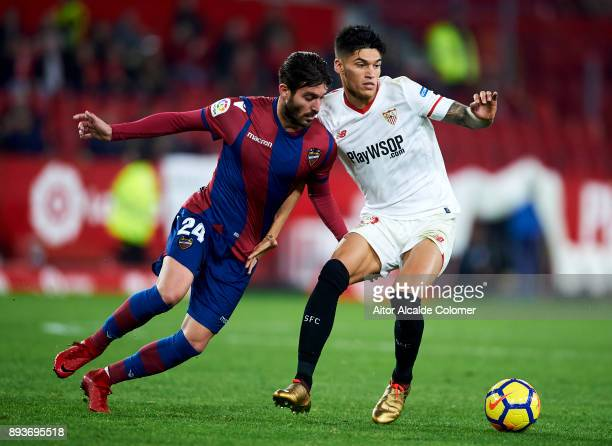 Joaquin Correa of Sevilla CF duels for the ball with Jose Campana of Levante UD during the La Liga match between Sevilla CF and Levante UD at Estadio...