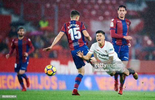 Joaquin Correa of Sevilla duels for the ball with Sergio Postigo of Levante during the La Liga match between Sevilla and Levante at Estadio Ramon...