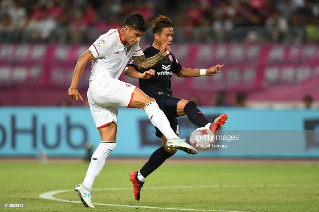 Joaquin Correa of Sevilla FC (L) and Riku Matsuda of Cerezo Osaka (R) compete for the ball during the preseason friendly match between Cerezo Osaka and Sevilla FC at Yanmar Stadium Nagai on July 17, 2017 in Osaka, Japan.