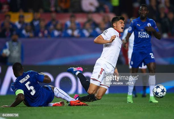 Joaquin Correa of Sevilla FC being fouled by Wes Morgan of Leicester City during the UEFA Champions League Round of 16 first leg match between...
