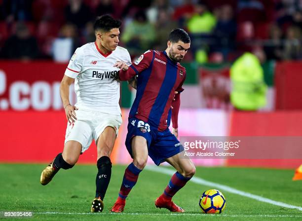 Joaquin Correa of Sevilla FC duels for the ball with David Remeseiro 'Jason' of Levante UD during the La Liga match between Sevilla FC and Levante UD...