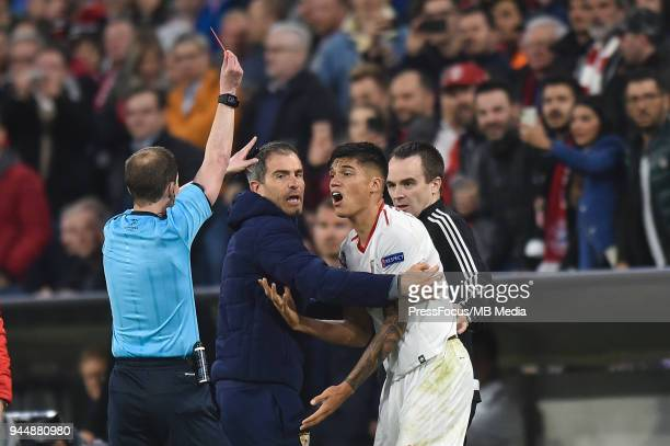 Joaquin Correa of Sevilla FC is awarded red card for tackling Javi Martinez of Bayern Muenchen during UEFA Champions League Quarter Final Second Leg...