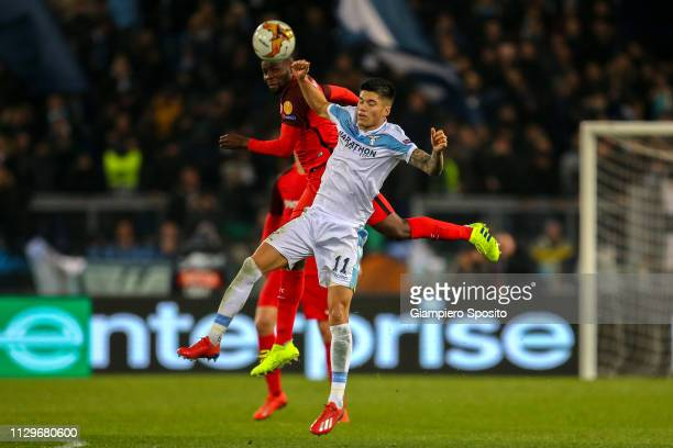 Joaquin Correa of SS Lazio and Ibrahim Amadou of Sevilla jump for the ball during the UEFA Europa League Round of 32 First Leg match between SS Lazio...