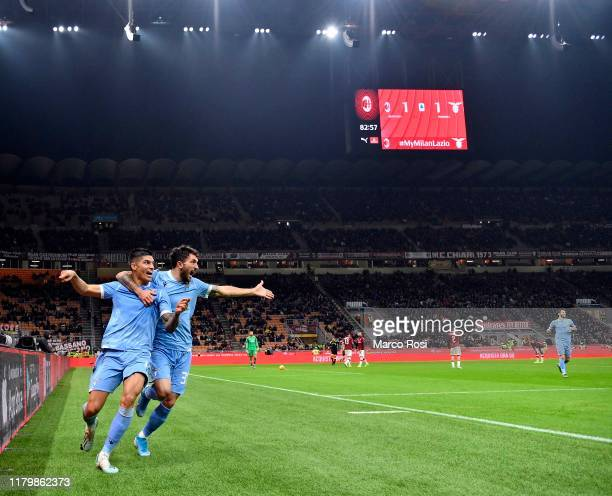 Joaquin Correa of SS lazio celebrates a second goal with his team mates during the Serie A match between AC Milan and SS Lazio at Stadio Giuseppe...