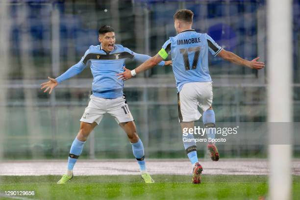 Joaquin Correa of SS Lazio celebrates with his captain Ciro Immobile after scoring a goal during the UEFA Champions League Group F stage match...