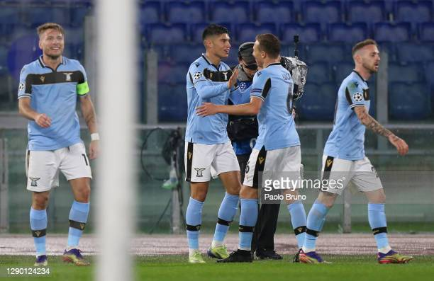 Joaquin Correa of SS Lazio celebrates with teammate Lucas Leiva of SS Lazio after scoring their team's first goal during the UEFA Champions League...