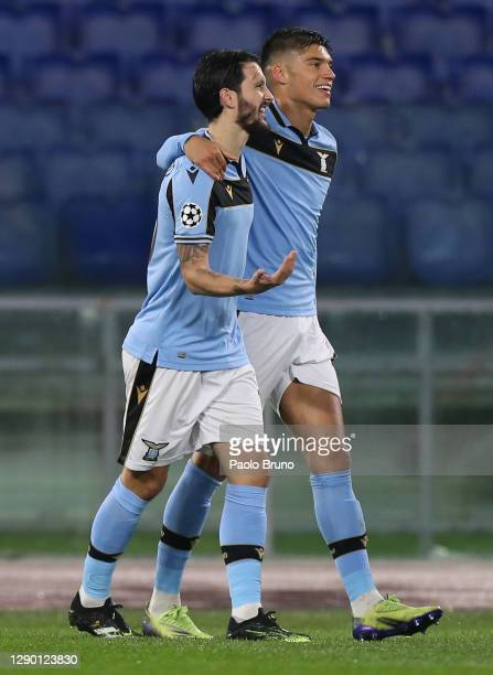 Joaquin Correa of SS Lazio celebrates with teammate Luis Alberto after scoring their sides first goal during the UEFA Champions League Group F stage...