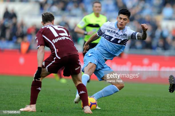 Joaquin Correa of SS Lazio compete for the ball with Cristian Daniel Ansaldi of Torino FC during the Serie A match between SS Lazio and Torino FC at...