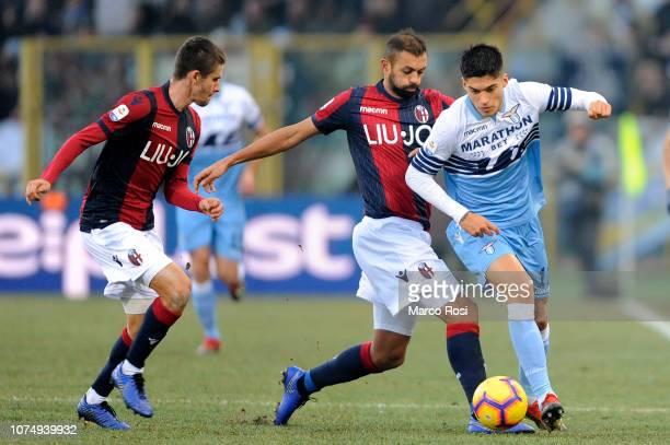 Joaquin Correa of SS Lazio compete for the ball with Danilo Larangeria of Bologna FC during the Serie A match between Bologna FC and SS Lazio at...
