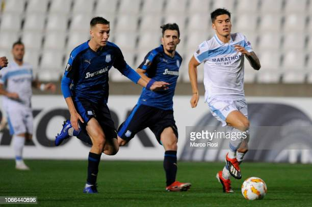Joaquin Correa of SS lazio compete for the ball with Dylan Quedraogo of Apollon Limassol during the UEFA Europa League Group H match between Apollon...