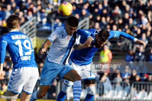 Joaquin Correa of SS Lazio compete for the ball with Jhon Carlos Chancellor of Brescia Calcio during the Serie A match between Brescia Calcio and SS...